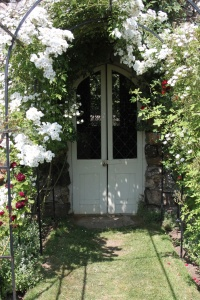 Folly with Rambling rector rose